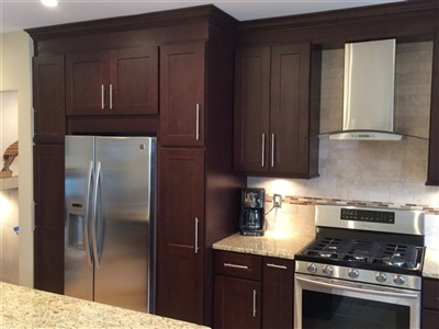 Maspeth Kitchen Ebony cabinet with gaillio ornamental